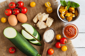 Ingredients for healthy pizza with zucchini crust and chicken
