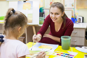A lesson in watercolor painting for preschool children