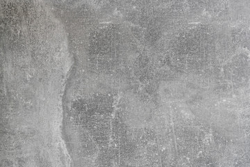 Gray textural background. Wall with grooves and cracks, fashionable background of natural cement.