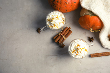 Flat lay composition with pumpkin spice latte and space for text on table