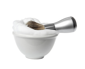 Shaving brush for men and bowl with foam on white background