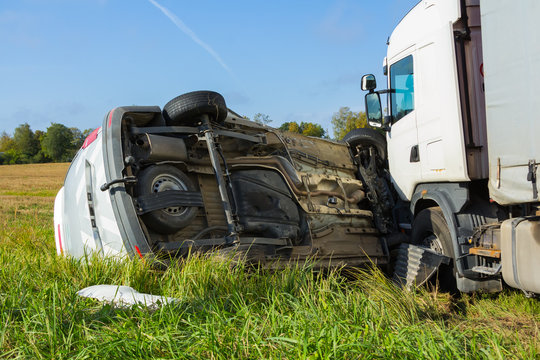 Car accident on a road in September, car after a collision with a heavy truck