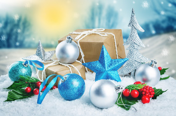 Christmas winter background with gifts, colored balls and star