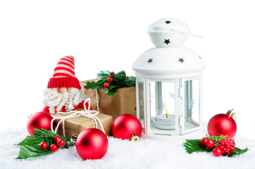 Christmas lantern with gifts, colored balls on a snow isolated background