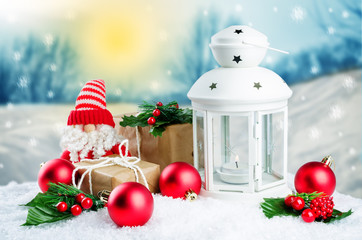 Christmas lantern with gifts, colored balls on a winter background
