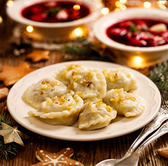 Christmas dumplings stuffed with mushroom and cabbage on a white plate. Traditional Christmas eve dish in Poland