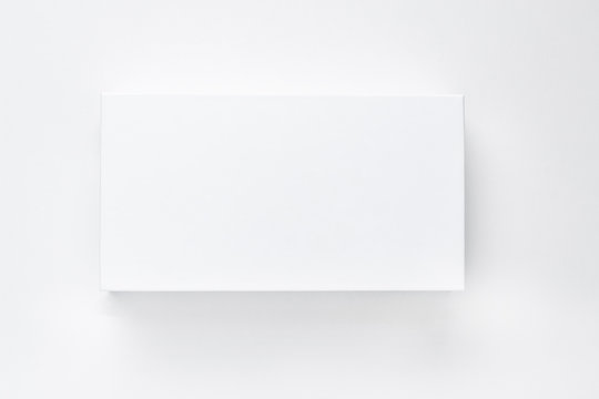White paper box with shadow on a white background isolate. Empty card mock up