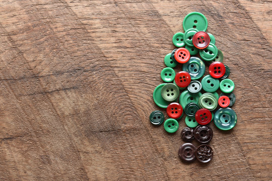 sewing buttons in the shape of a christmas tree