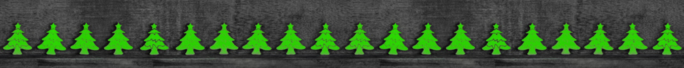 Christmas decoration wooden background with row of small wooden fir trees seamless banner