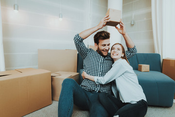 Young Couple During A Move To A New Apartment.