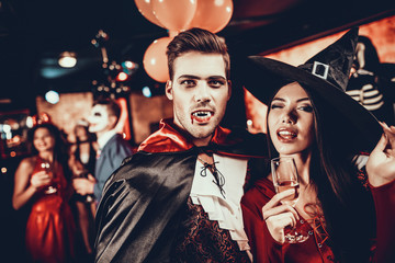 Wall Mural - Young Happy Couple in Costumes at Halloween Party
