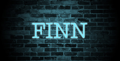 first name Finn in blue neon on brick wall