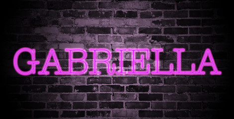 first name Gabriella in pink neon on brick wall