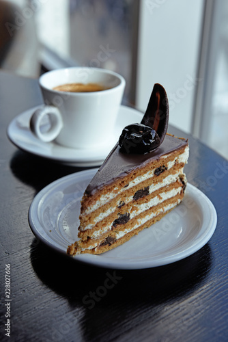 A Delicious Piece Of Chocolate Birthday Cake On Table Next To White Coffee Cup With