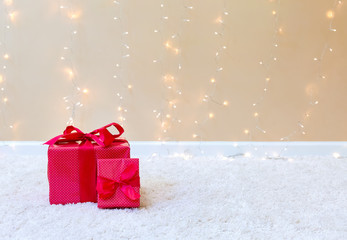 Christmas gift boxes on a carpet over a shiny light background