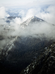 Foggy mountain covered in snow