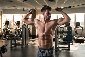Muscular Man Exercising Chest