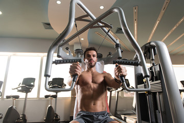 Fitness Man Exercising Chest In The Gym