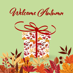 Autumn background with Welcome Autumn text with Present box decorated with colorful leaves and ribbon and autumn leaves frame.