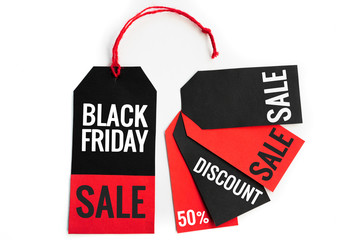 Black friday. black and red sale tag on white background