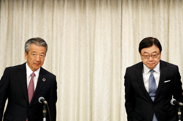 Showa Shell CEO Tsuyoshi Kameoka and Idemitsu Kosan President and CEO Shunichi Kito attend their joint news conference in Tokyo