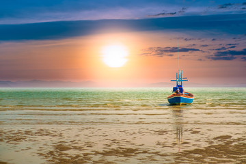 Fishing boat in the sea to catch fish out the morning sunset on a beautiful day. Pictures of imagination.hope and success concept