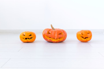 Halloween pumpkin heads jack lantern with scary evil faces spooky holiday