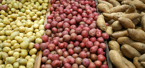 Fresh potatoes and sweet potato in the supermarket for sale