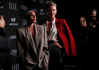 Honorees Lady Gaga and Charlize Theron pose at the 25th annual ELLE Women in Hollywood in Los Angeles