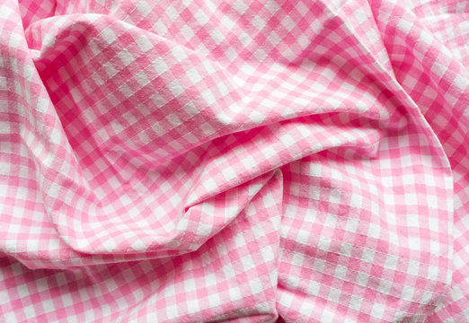 Full frame close up view of crumpled pink and white gingham fabric