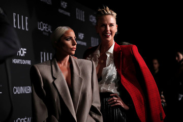 Honorees Lady Gaga and Theron pose at the 25th annual ELLE Women in Hollywood in Los Angeles