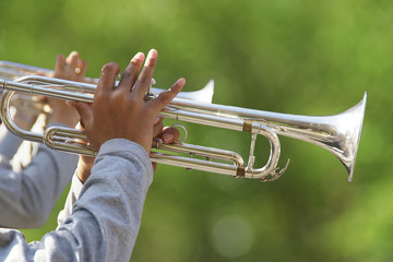 Closeup of Hands Holding the Trumpets with Nature Background
