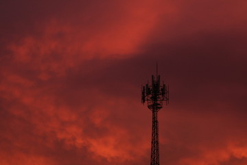 red sky at night and antenna