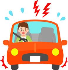 自動車の運転中に慌てる若い男性