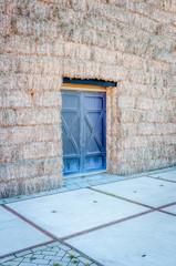 Door in a wall of hay