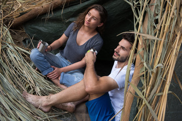couple spending time together in straw tent