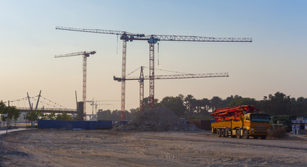 construction cranes and truck with concrete pump