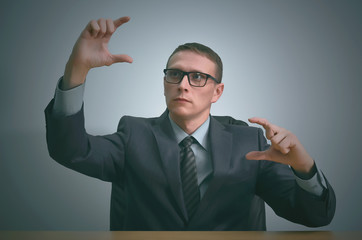 Businessman is holding in hands a copy space objects.