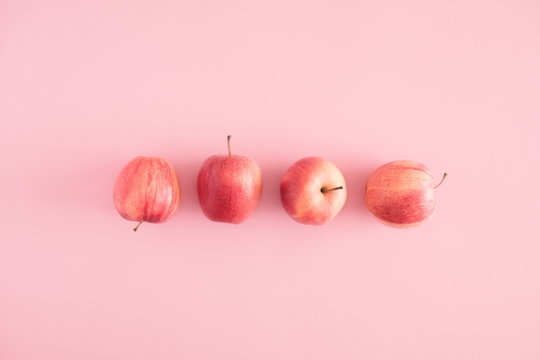 Autumn composition. Apples on pastel pink background. Autumn, fall creative concept. Flat lay, top view, copy space