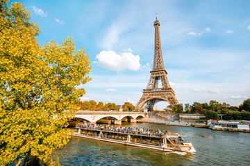 View on the Eiffel tower on Seine river during the autumn in Paris