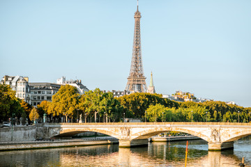 Landscape view of the riverside with Eiffel tower during the morning light in Paris