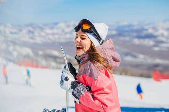cheerful woman snowboarder laughs