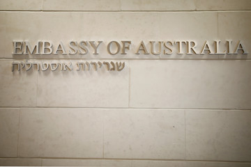 A Hebrew and English sign is seen at the entrance to the Australian Embassy in Tel Aviv