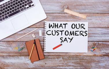 Customer Testimonial message on office flat lay