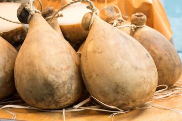 Many forms of caciocavallo cheese dop sale in Italian market