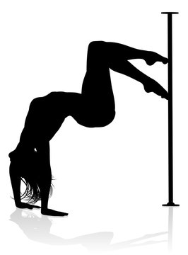 A woman pole dancer exercising for fitness in silhouette
