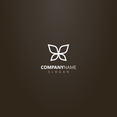 white logo on a black background. simple vector outline logo of line art butterfly wings