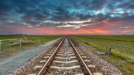 Fototapeten Eisenbahnschienen Railroad panorama in open rural countryside