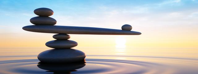 Steine in Balance - Gleichgewicht bei Sonnenaufgang im Meer