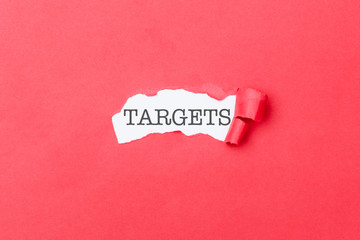 Targets word behind ripped piece of paper